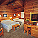 Buckrail Lodge - lodgepole cabin style rooms - Spacious log rooms & Western decor just minutes from Town Square. Family-owned, flower-laden gardens, hot tub, smoke free environment & quiet solitude. NEW 2014 VIDEO.